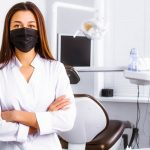 Dentist in her office wearing mask - Top Dental PPO Negotiator - PPO Negotiation and Optimization